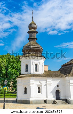 An old orthodox church with wooden roof - a part of the St. Michael monastery. Kyiv, Ukraine. - stock photo