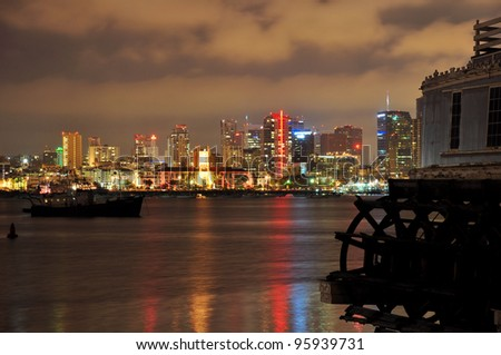 An old paddle wheel boat frames this view of the San Diego, California skyline. - stock photo