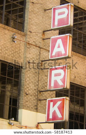 An old parking garage sign - stock photo