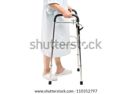 An old patient using a walker isolated against white background - stock photo