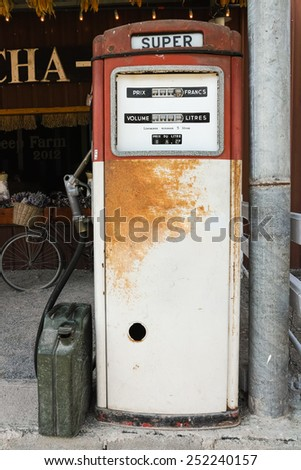 An old rusty and vintage gasoline pump which out of service - stock photo