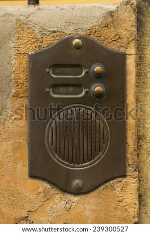 An old, rusty intercom in Italy. - stock photo