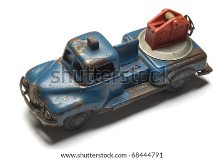 an old rusty toy tow truck on white - stock photo
