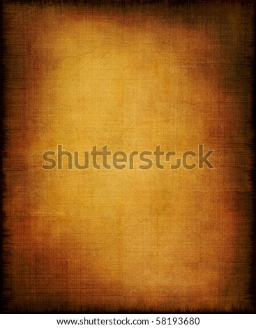 An old section of cloth and paper with a golden center and vignette effect. - stock photo