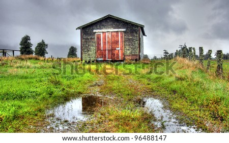 an old shack in the New Zealand mountains - stock photo