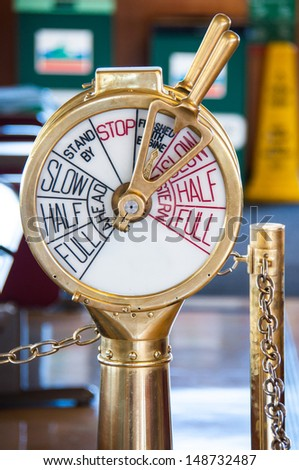 An old ship telegraph stands on the deck of a ferry - stock photo