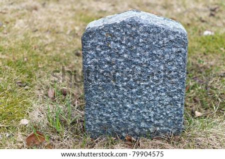 An old small empty tombstone on a graveyard - stock photo