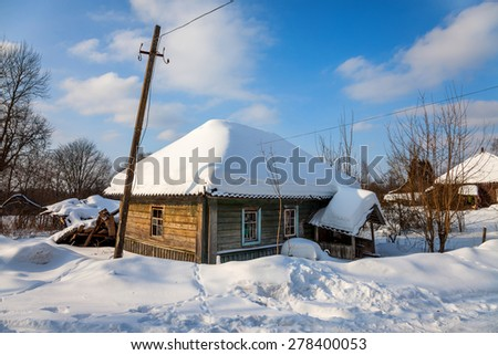 an old snow covered house in Russia. - stock photo