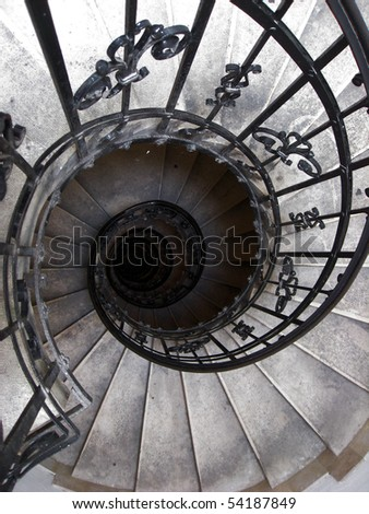 An old spiral staircase. - stock photo