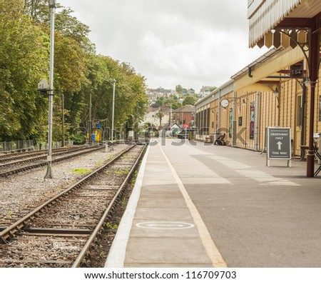 An Old Steam Time Railway Station Showing the Rails and the Platform - stock photo