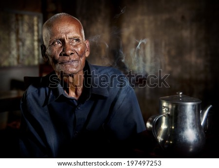 An old tea house and a man in it. - stock photo