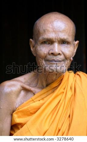An old Thai monk. - stock photo