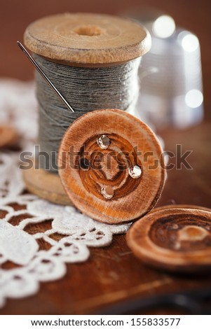 an old thimble and lace backdrop, shallow dof - stock photo