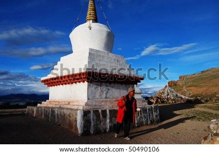 An old Tibetan man, who lived on Namtso, just finished his prayer. - stock photo