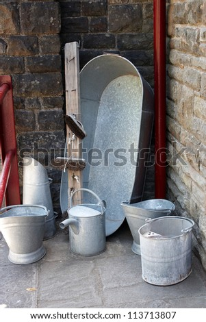 An old tin bath with antique utility equipment - stock photo