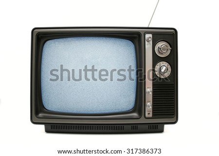 An old TV with static on the screen. - stock photo