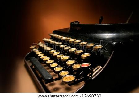 an old typewriter on orange background - stock photo