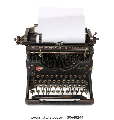 An old typewriter with a blank paper - stock photo