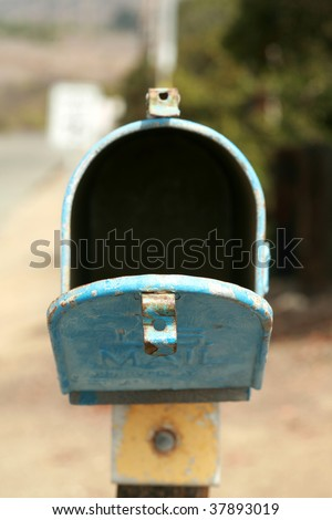 an old us postal mail box outdoors - stock photo