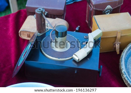 An old vintage record player for sale in a flea market - stock photo
