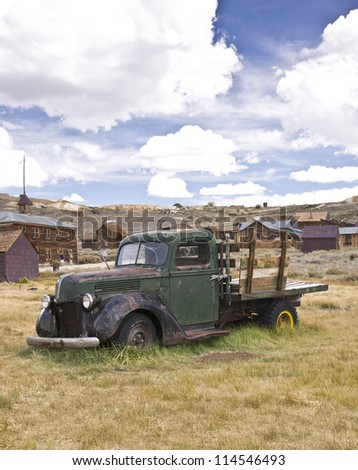An old vintage truck rests where it died in a California gold rush ghost town - stock photo