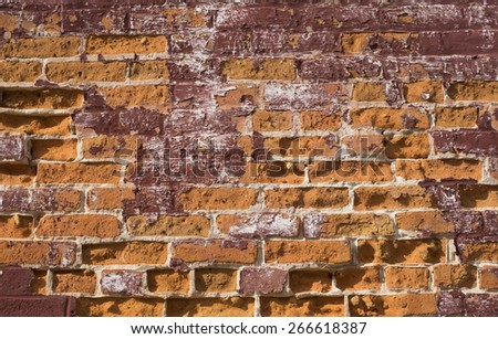An old wall of handmade multicolored bricks. - stock photo