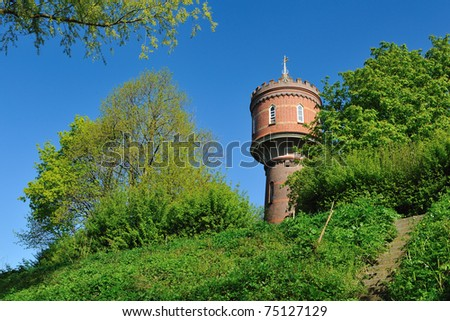 An old watertower in the Netherlands during springtime - stock photo