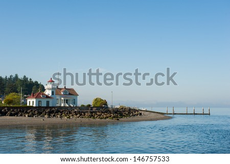 An old white house in the Puget Sound of Washington - stock photo