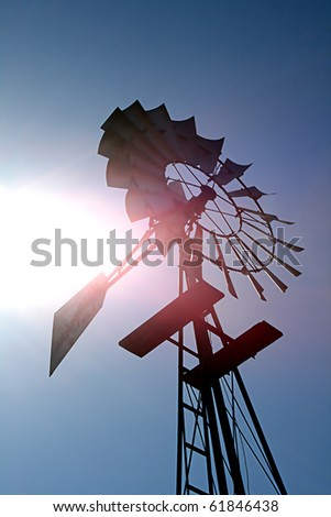 An old windmill waiting for a breeze. - stock photo