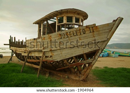 An old wooden boat on a South American Beach. - stock photo