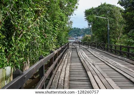 An old wooden bridge in Sangklaburi, Thailand - stock photo