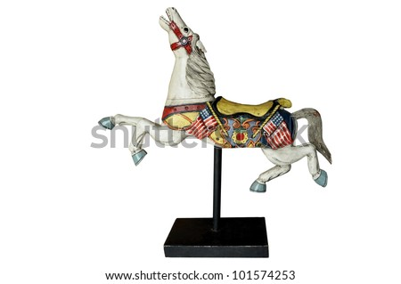 an old wooden colorful horse standing on a base - stock photo