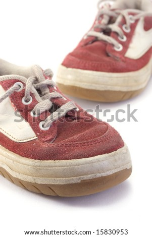 An old worn pair of children's shoes. - stock photo