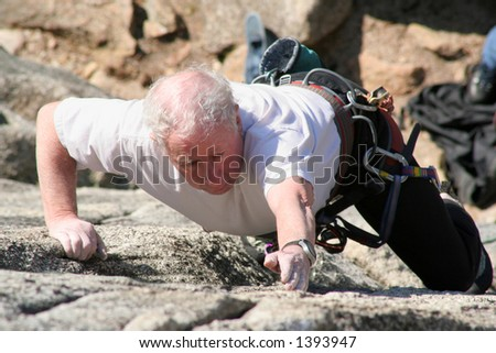 An older rock climber. - stock photo