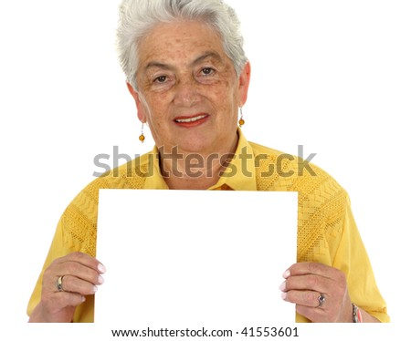 An older smiling woman in a yellow shirt whit a banner - stock photo