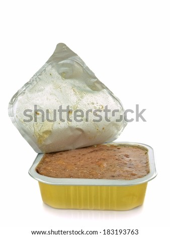 An open aluminum tin of pet food on a white background - stock photo