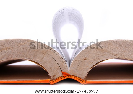 an open book with sheet forming waves on a white background - stock photo