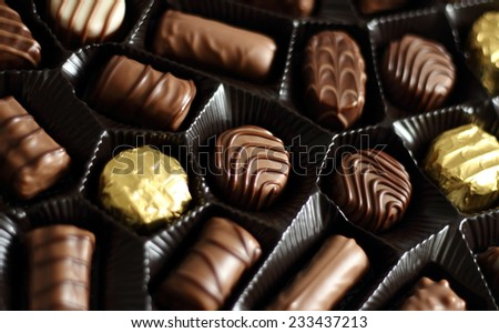 An open box of delicious chocolate candy - stock photo