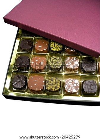 An open box with the chocolates, isolated - stock photo