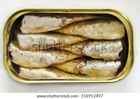 an open can of sardines on a white background - stock photo