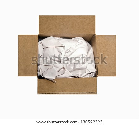 An open cardboard box filled with packing paper. - stock photo