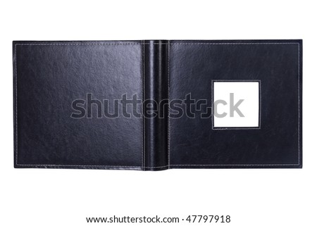 an open photo album with an empty insert - stock photo
