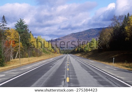 An open road on scenic Route 302 in Crawford Notch, New Hampshire - stock photo