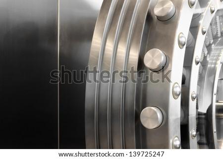 An open safe door in a vault - stock photo