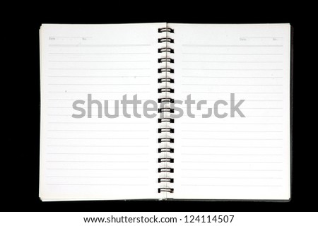 an opened notebook isolated on black background - stock photo