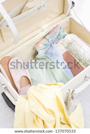 An opened suitcase - stock photo