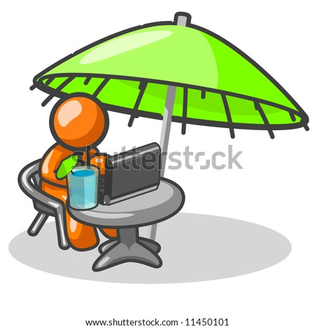 An orange at his computer working on his vacation. - stock photo