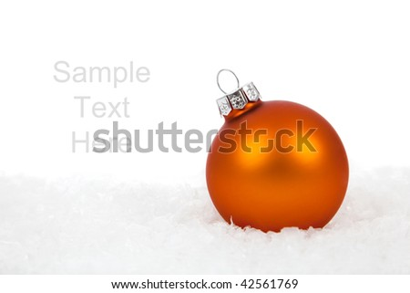 An orange Christmas ornaments/baubles on a white background with copy space - stock photo