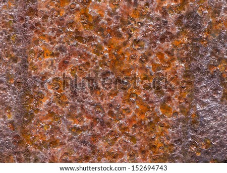 an orange rusted metal surface extremely weathered - stock photo