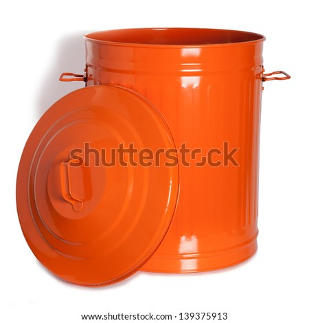 An orange, vintage garbage with lid on the side - stock photo